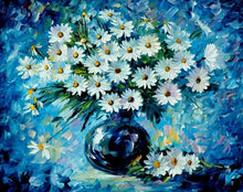 Abstract blue wall and white daisies