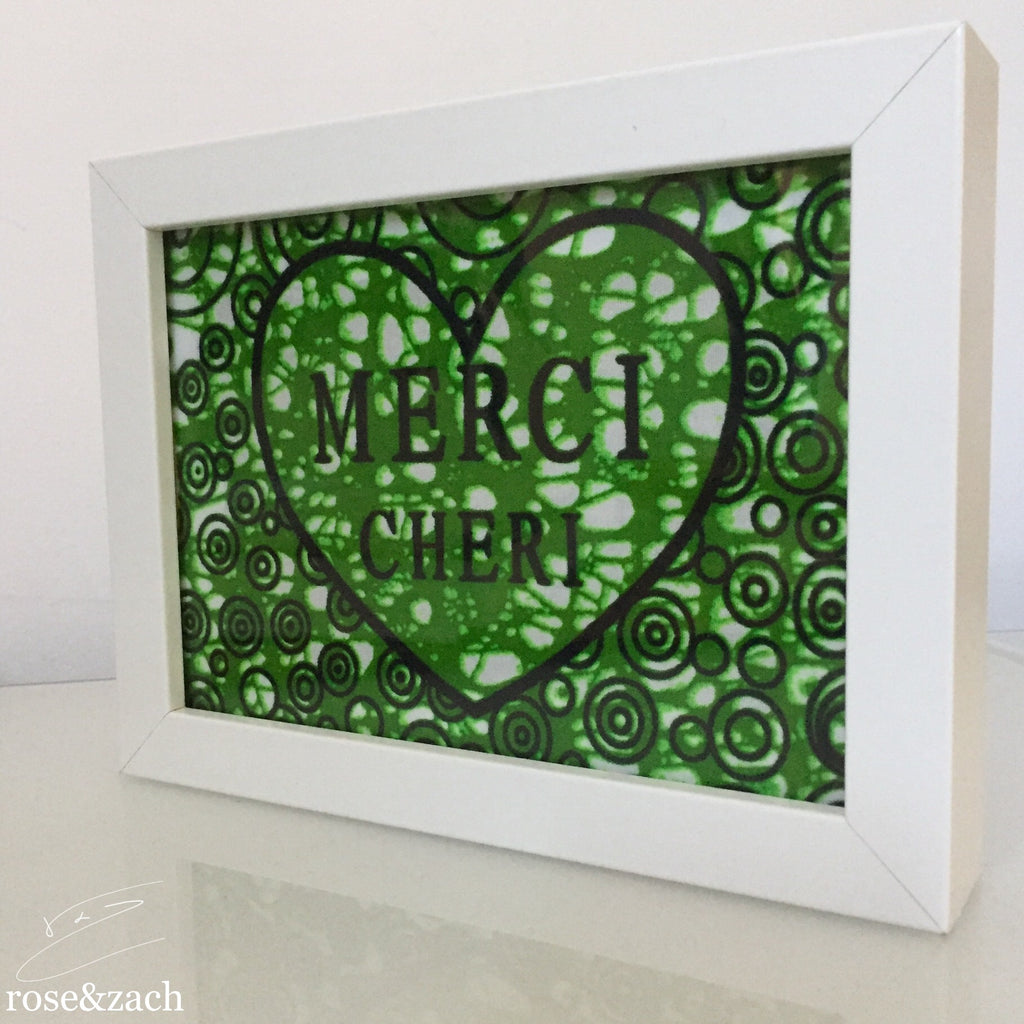 Frame 'MERCI CHERI' in Green Wax Print