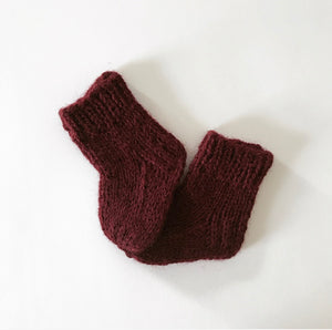 Handknitted doll socks