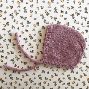 Handknitted doll bonnet