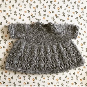 Handknitted doll dress