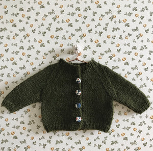 Handknitted doll cardigan