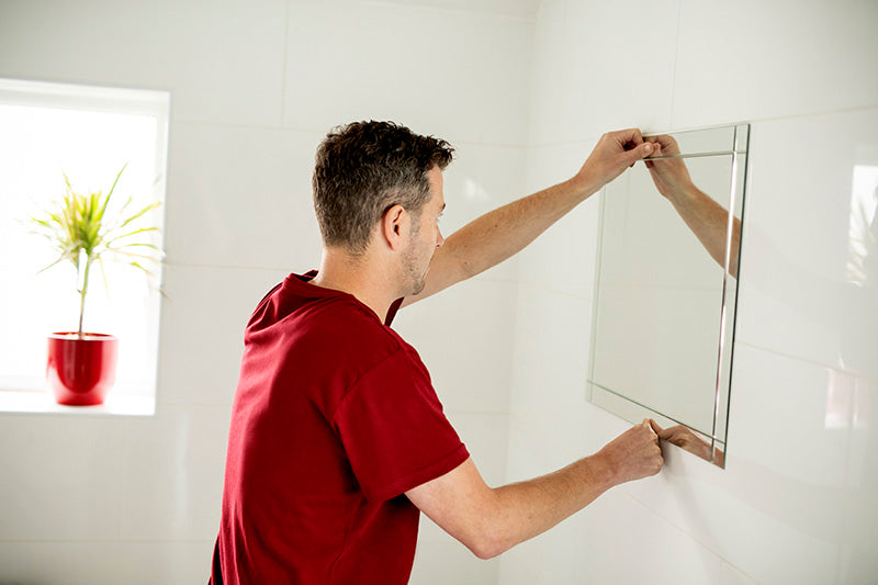 How to Mount a Mirror on Tiles Without Nails or Drilling