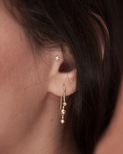 Gold plated silver hook earring Venus Stars from Kinz Kanaan. Set with cubic zirconiuas. Festive sparkly earrings.