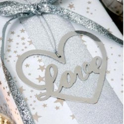 Retreat-home collection - silver heart with the words 'Love' on the inside. Come in presentation packaging and hang from silver string.