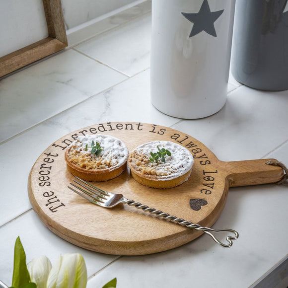 "Retreat - Round Wooden Chopping Board ""The Secret Ingredient is Love"" Small"