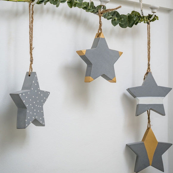 Retreat - Grey, gold and white patterned hanging wooden stars