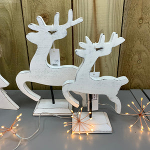 Whitewashed Reindeers on Stand