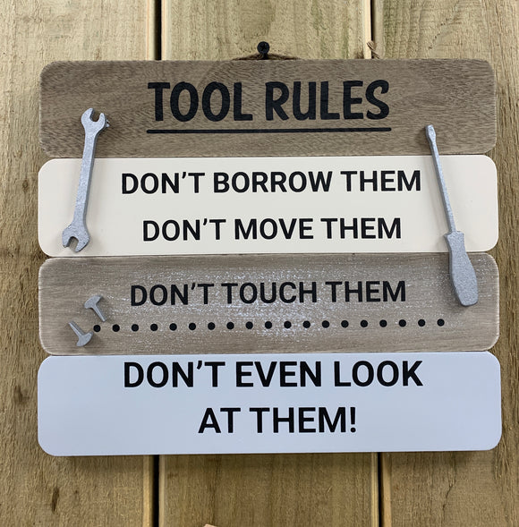 'Tool Rules: Don't borrow them, Don't move them, Don't touch them, DON'T EVEN LOOK AT THEM!' - sign