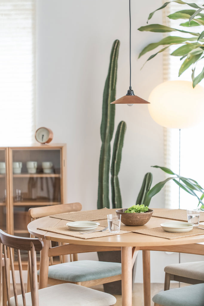 wooden round table with plants
