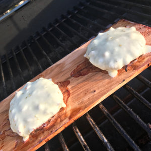 cheeseburgers on wood grilling board