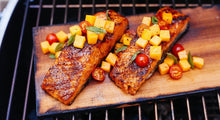 cooking fish on grilling boards