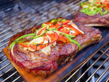 Steak on wood grilling board