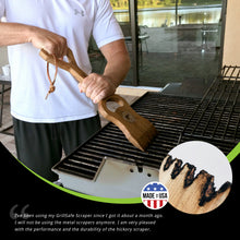 man cleaning grill with grillsafe wooden grill scraper