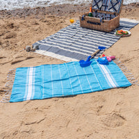 Nicola Spring 100 x 60cm Turkish Cotton Beach Towel - Blue on Beach