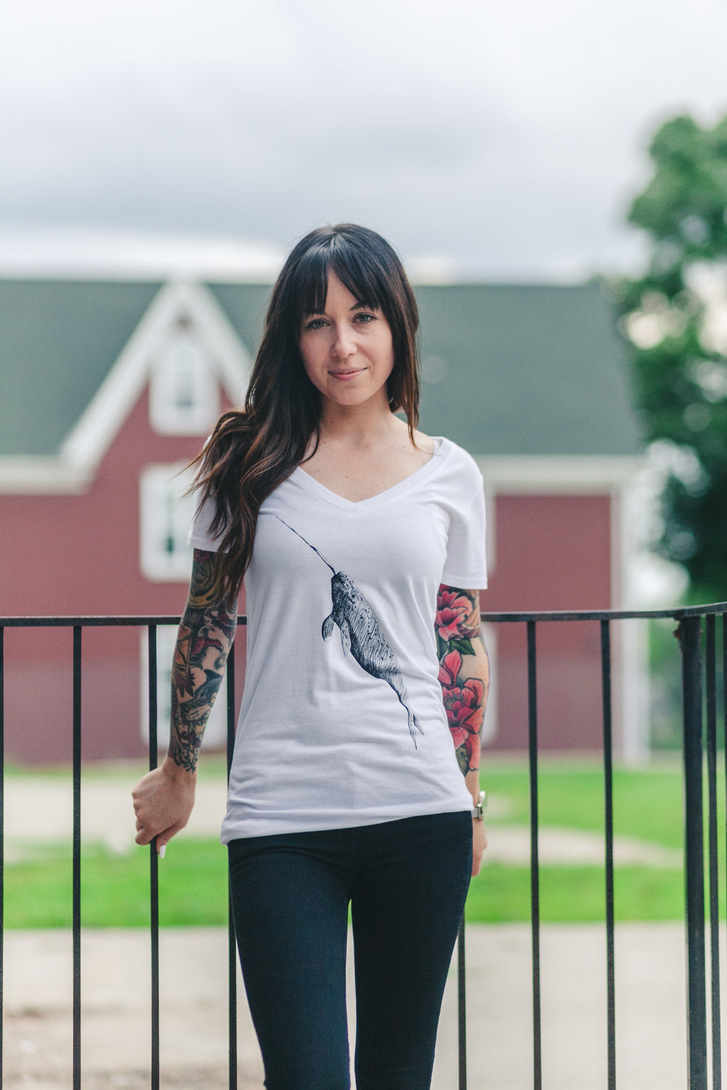 White tee with narwhal on front