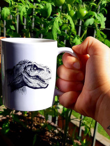 11 oz White ceramic coffee mug with T-Rex dinosaur graphic on the front in black