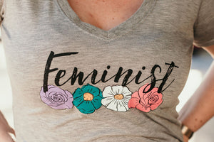 Up close shot of the Feminist design with four flowers in multiple colours