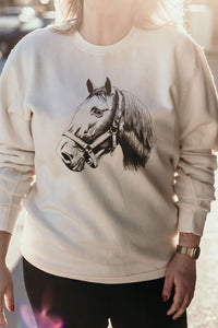 Cream coloured crew neck pullover sweatshirt with horse design on front