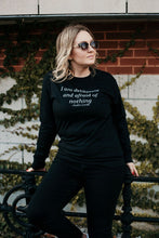 Long sleeved jersey shirt in black with I am deliberate