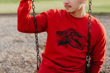 Red unixes pullever sweatshirt with T-Rex dinosaur design in black ink on front
