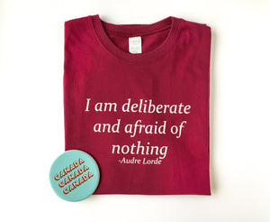 "Fine jersey t-shirt in maroon with the ""I am deliberate and afraid of nothing"" saying"
