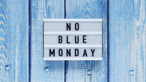No Blue Monday sign on blue wall