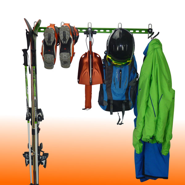 GearHooks ski rack with 1 pair of skis and poles, 1 pair of ski boots, avalanche transceiver, probes and shovel, rucksack, helmet and clothes.