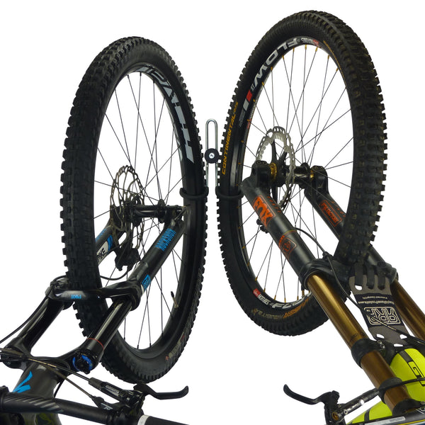 Double bike storage hook with 1 mountain bike and 1 downhill bike