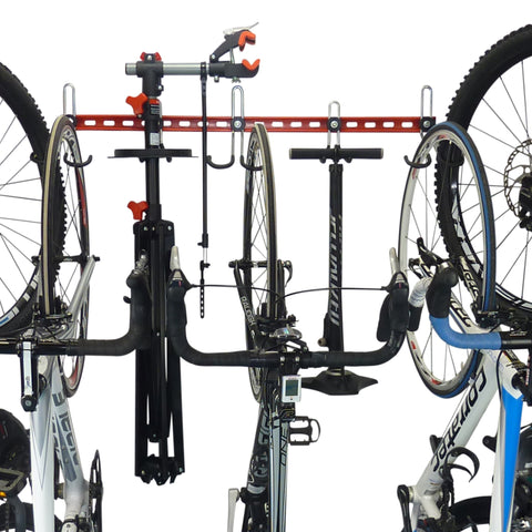 Bike storage rail and bike storage hooks with space for additional GearHooks for trackpump, maintenance stand, helmets, clothing, tools and spares