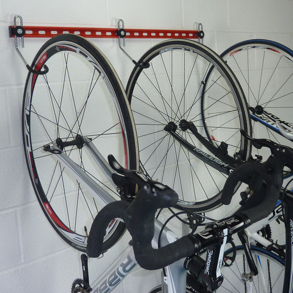 GearHooks® 3 bike vertical bike storage rack shown with with 3 road bikes