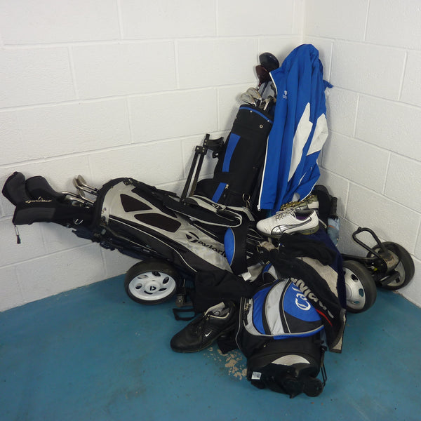 Pile of golf equipment in need of a GearHooks golf organiser rack