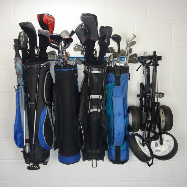 Golf bag storage rack with 4 full golf bags and 2 trolleys