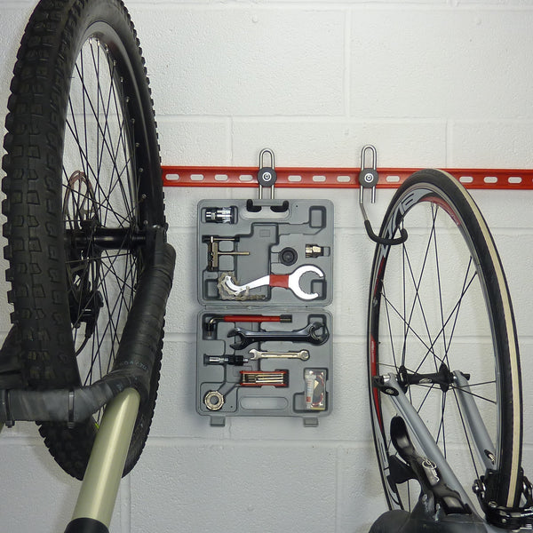 tool storage hook mounted between the bikes on a GearRail.