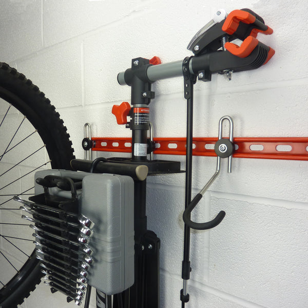 300mm long storage hook for workstand, pump, and tools mounted between the bikes on a GearRail.