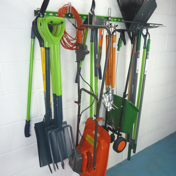 Garden tool rack for 25+ tools holding spades, shovels, fork, lawn edger, hoe, shears, rakes, lawn mower and seed spreader