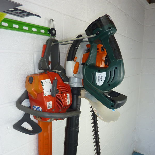 Heavy duty garden tool rack hook with petrol chainsaw, petrol leaf blower and electric hedge trimmer on one hook