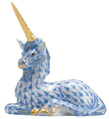 Blue patterned ceramic unicorn with golden horn