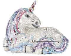 A crystal encrusted clutch purse shaped like a unicorn lying down