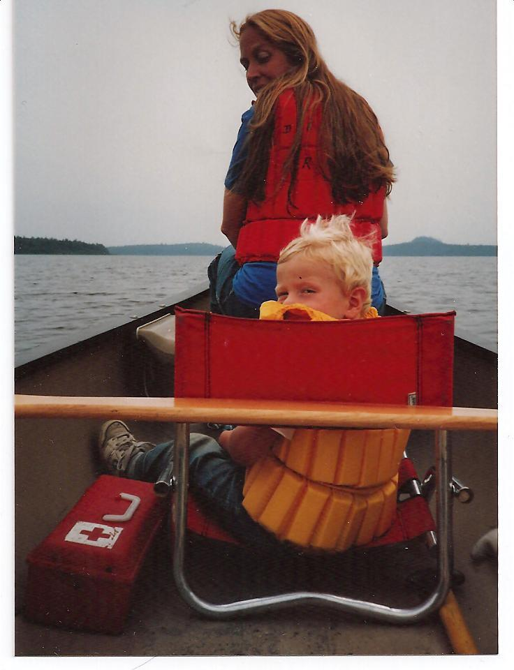 mom and little boy in canoe