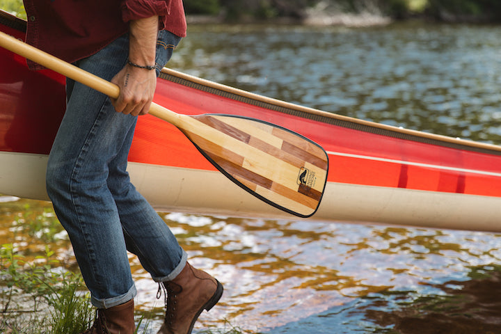 canoeist with paddle and canoe