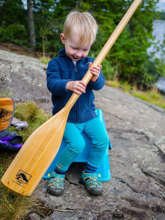 little guy with bending branches twig canoe paddle