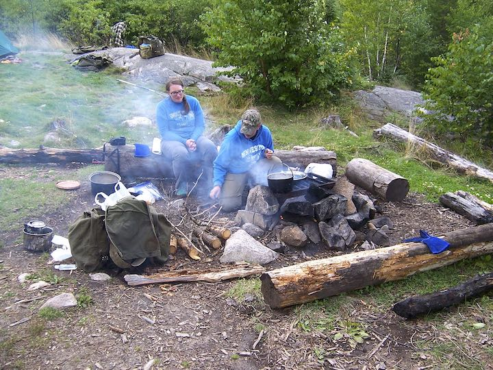 canoe trip cooking over a campfire