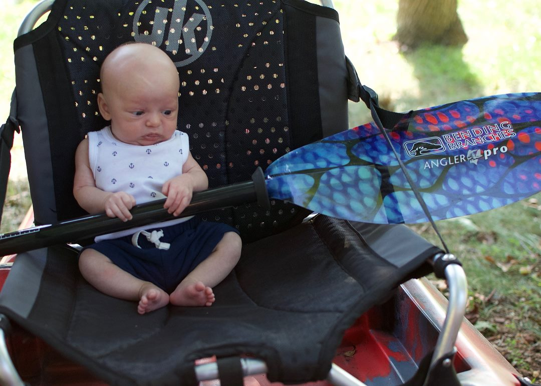 baby with kayak paddle