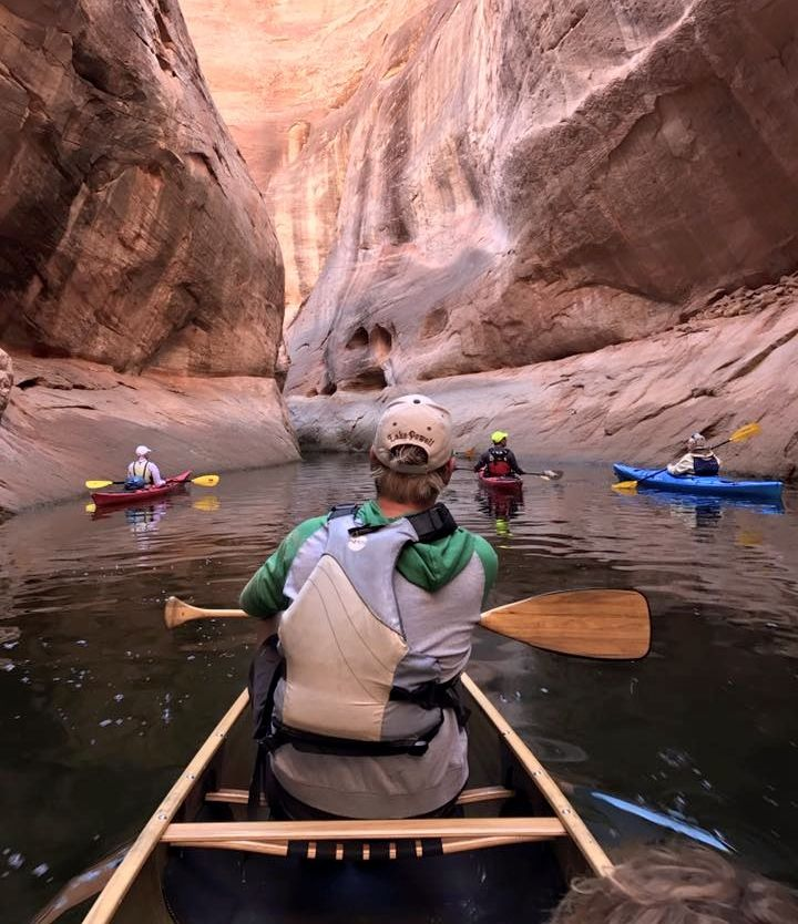 paddling in a lake powell canyon