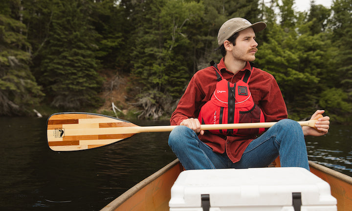 canoeist with bending branches paddle