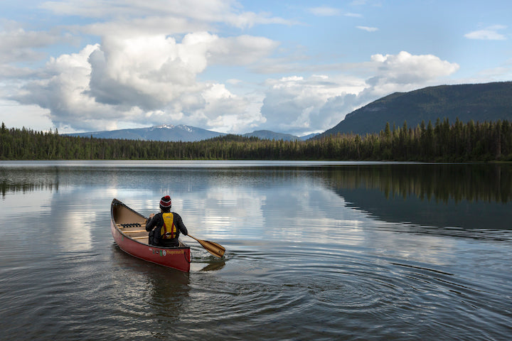 solo canoeist with single-blade paddle