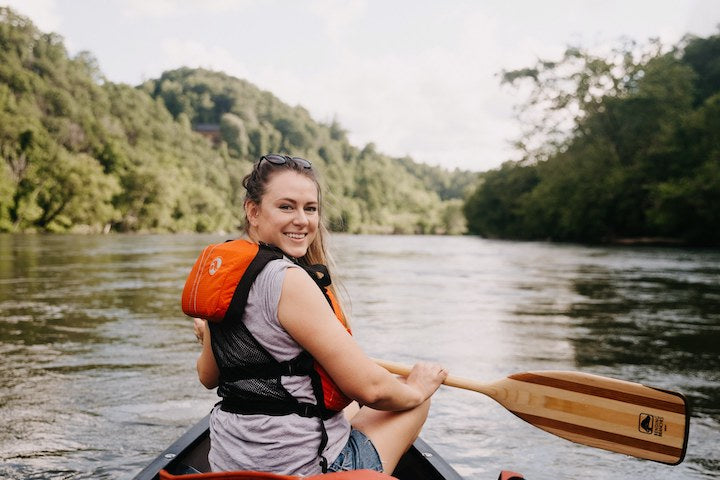 young woman canoeing