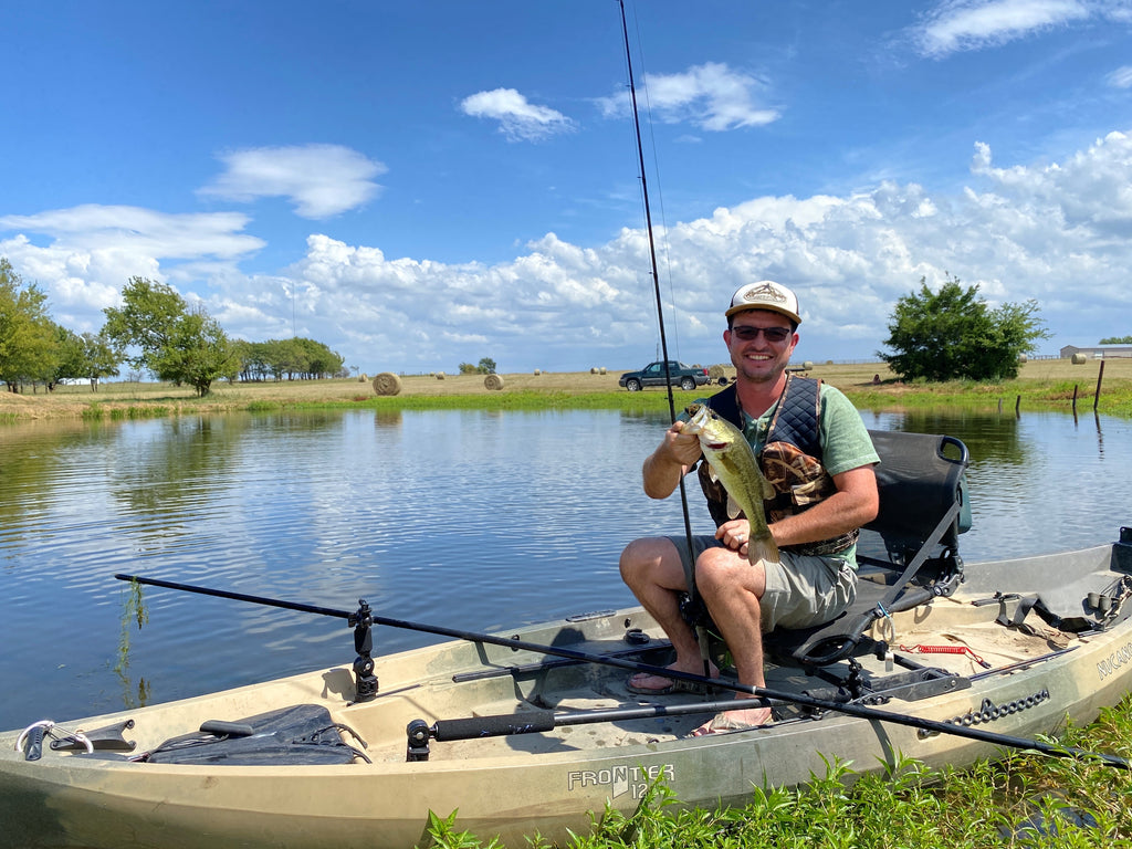 Author Wesley Littlefield fishing from a kayak