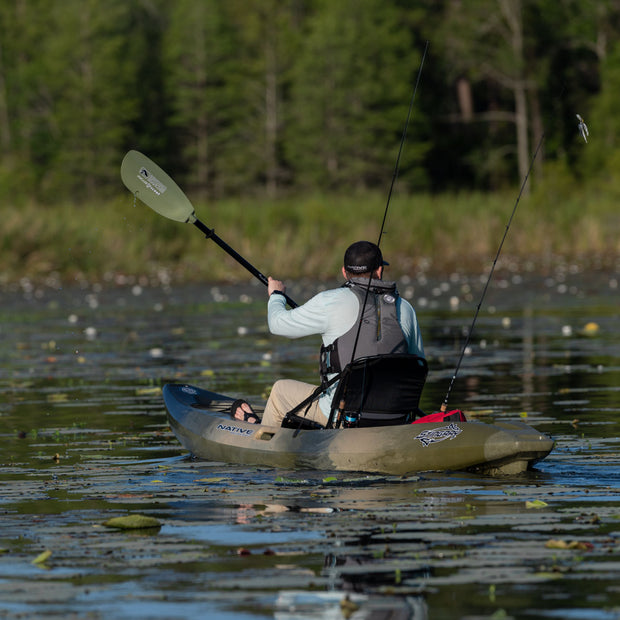 Kayak angler paddling away from camera